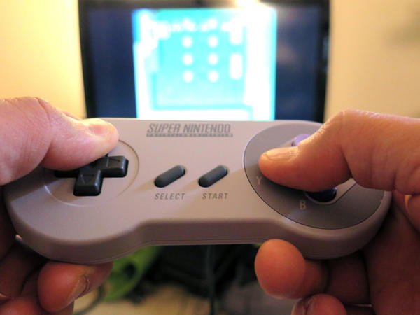 The Super NES Classic, a mini-version of one of the first Nintendo consoles, comes with a vintage controller.