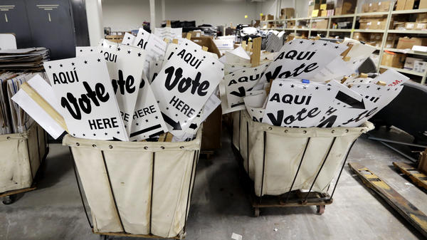 Bins of signs are seen at an election office in San Antonio, Texas. The first primaries of the 2018 elections are less than a month away, and the Department of Homeland Security held a classified briefing last week to further explain voter system threats to election directors and secretaries of state.