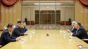 Secretary of State Mike Pompeo and CIA official Andrew Kim, both at right, meeting with North Korean leader Kim Jong Un on May 9 in the capital Pyongyang.
