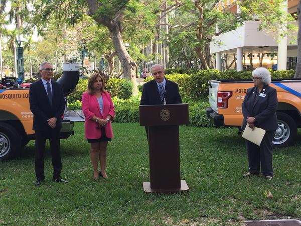 From left, director of the Miami-Dade County Mosquito Control Division Dr. William Petrie, Deputy Mayor Alina Hudak,  Mayor Carlos Giménez, and Administrator for the Florida Department of Health in Miami-Dade County Dr. Lillian Rivera.