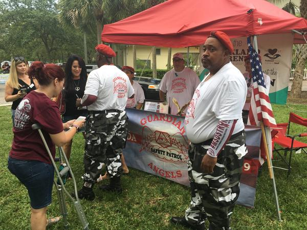 Guardian Angels receive thanks and hugs from parents at a booth they set up in Pine Trails Park in Parkland.