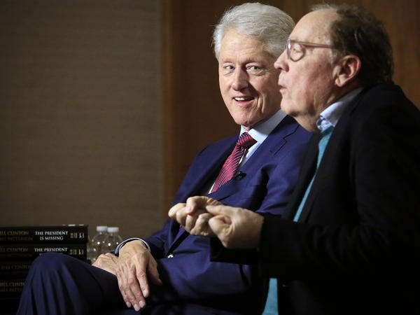 Former President Bill Clinton (left) listens as author James Patterson speaks during an interview about their new novel, <em>The President is Missing</em>, in New York on May 21.