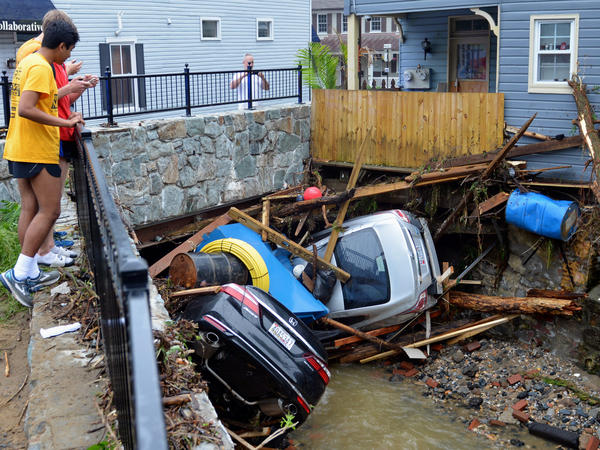Debris and cars clog the Patapsco River in Ellicott City, Md., after flooding on May 27 that killed one person and destroyed much of the town's Main Street.