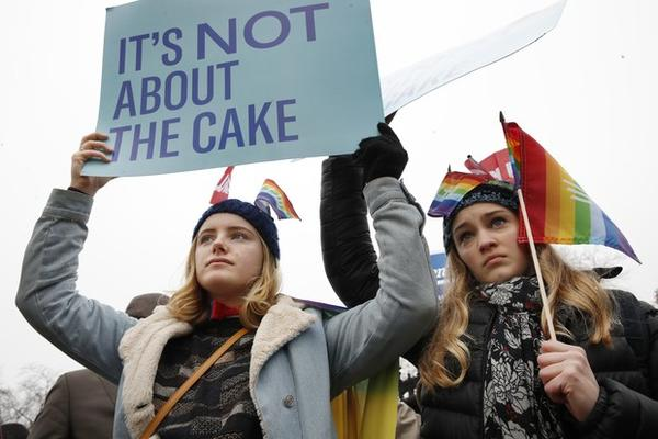 <p>Lydia Macy, 17, left, and Mira Gottlieb, 16, both of Berkeley, Calif., rally outside of the Supreme Court which is hearing the 'Masterpiece Cakeshop v. Colorado Civil Rights Commission.</p>