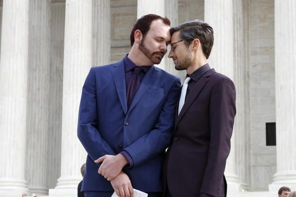 <p>Charlie Craig, left, and David Mullins touch foreheads after leaving the Supreme Court Tuesday, Dec. 5, 2017.</p>