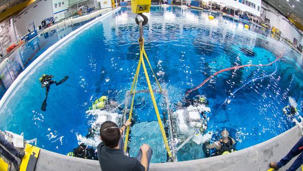 Astronauts train at the Neutral Buoyancy Laboratory (NBL) near NASA's Johnson Space Center.