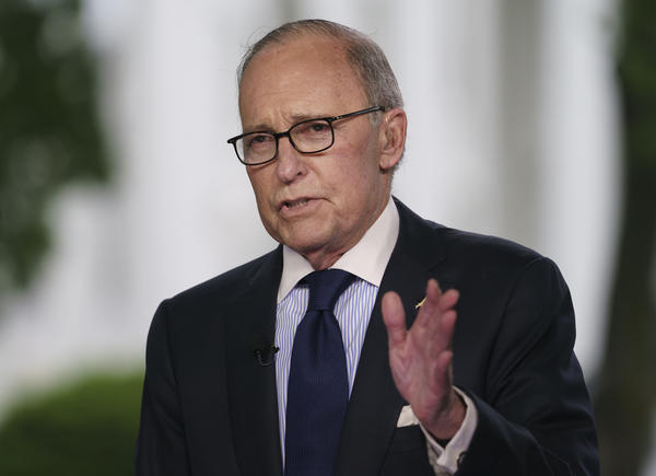 White House chief economic adviser Larry Kudlow speaks during a television interview outside the West Wing of the White House on May 18. President Trump tweeted that Kudlow suffered a heart attack and is hospitalized at Walter Reed Medical Center.