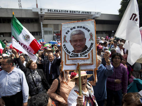 Supporters await the arrival of presidential candidate Andres Manuel López Obrador at a Mexico City rally last month.