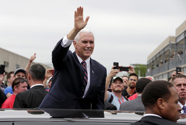 Vice President Mike Pence waves to race fans during a practice session for the IndyCar Indianapolis 500 auto race at Indianapolis Motor Speedway, in Indianapolis Friday, May 18, 2018.
