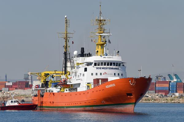 The Aquarius rescue ship enters the port of Valencia on Sunday. The 630 migrants whose rescue sparked a major migration row in Europe began disembarking in Spain after a turbulent week that saw Italy turn away the Aquarius ship.