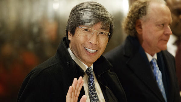 In this Jan. 10, 2017, file photo, pharmaceuticals billionaire Dr. Patrick Soon-Shiong waves as he arrives in the lobby of Trump Tower in New York for a meeting with President-elect Donald Trump. Soon-Shiong will take over the <em>L.A. Times </em>on Monday.