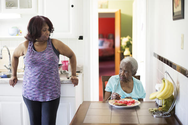 Sharon Wade keeps an eye on Martha Wade, her 86-year-old mother, after serving her an afternoon snack.