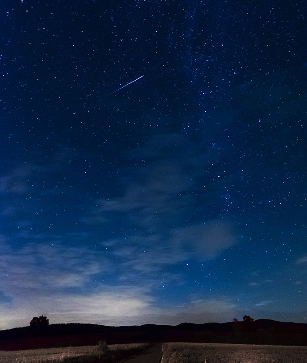 A meteor is captured over Poland during the annual Persied shower.