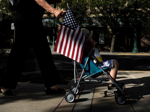 A child rides in a stroller during a rally in El Paso, Texas Thursday to protest the Trump administration's family separations.