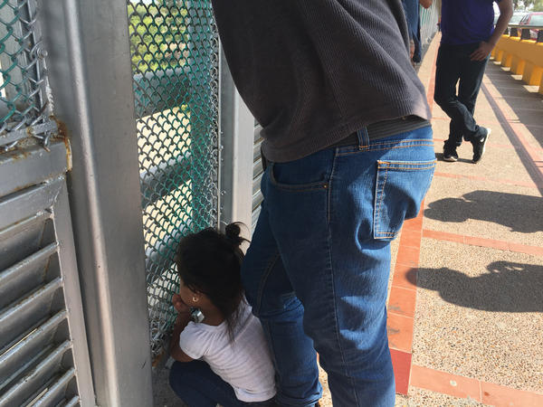 Rosa's 3-year-old granddaughter waits at the checkpoint. (Shannon Dooling/WBUR)