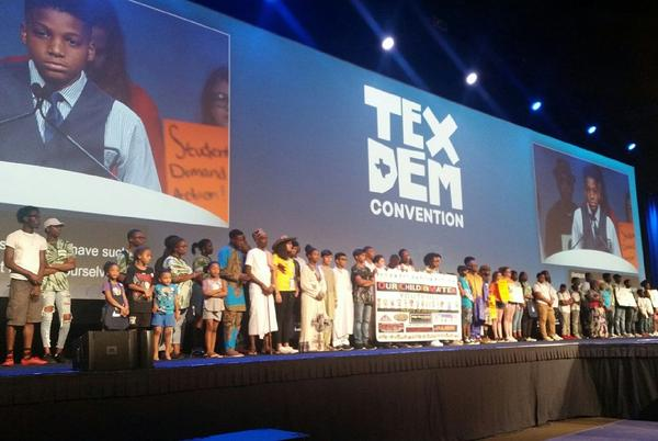 Families stand on stage during the Texas Democratic Convention in Fort Worth on Friday.