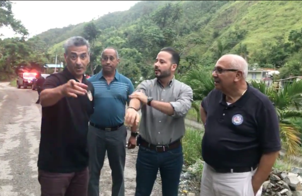 Miami state Representative Robert Asencio (left) with Luis Javier Hernandez, the mayor of Villalba, Puerto Rico (center) and Florida state Senator Victor Torres (right) inspecting roads in Puerto Rico still not cleared after last year's Hurricane Maria.