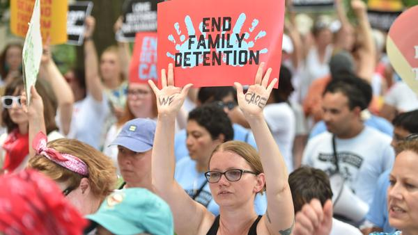 "People demonstrate in Washington, D.C., on Thursday, demanding an end to the separation of migrant children from their parents. On Friday, the Justice Department said in a court filing that ""the government will not separate families but detain families together during the pendency of immigration proceedings."""