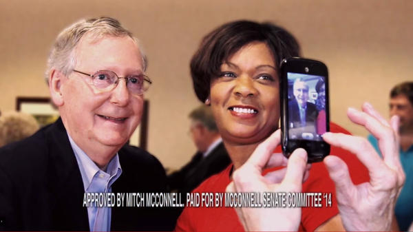 Sen. Mitch McConnell, R-Ky., poses with constituent Noelle Hunter. In a campaign ad, Hunter explains that McConnell helped get her daughter back from Mali after a custody battle.