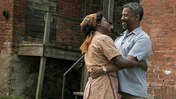 """Denzel Washington says his character, Troy, """"thinks he can control death and the devil, and he finds out in the worst way that he can't."""" Washington stars alongside Viola Davis in <em>Fences</em>."""