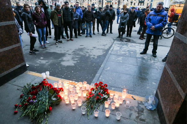 Flowers and candles in memory of the St. Petersburg Metro explosion victims on Monday at Sennaya station.