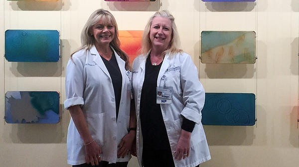 Nurse practitioners Carla Saunders (left) and Kyle Cook at the East Tennessee Children's Hospital earlier this year.