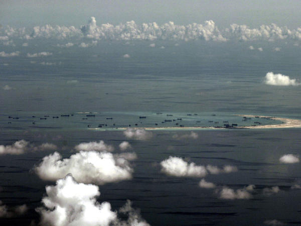 This photo taken from a U.S. military plane shows Chinese activity at Mischief Reef in the Spratly Islands in the South China Sea. China is building military facilities on disputed reefs and islands in the South China Sea.