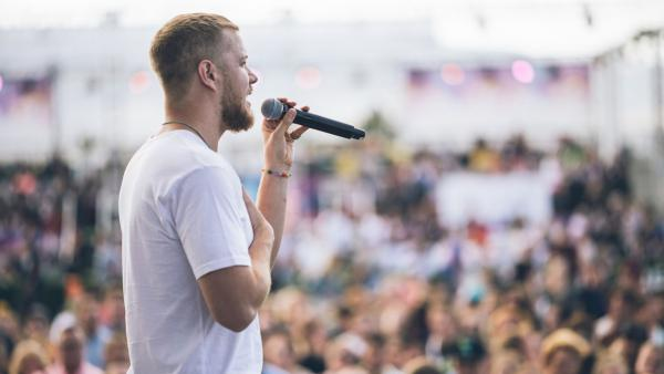 Dan Reynolds addresses the crowd at the 2017 LoveLoud Festival in Orem, Utah. The Imagine Dragons frontman helped organize the event to benefit LGBTQ rights organizations.