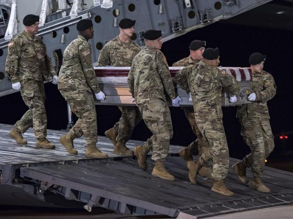 The remains of Staff Sgt. Dustin Wright are transferred at Dover Air Force Base, Del., in October. Wright and three other American soldiers were killed in an ambush in Niger.