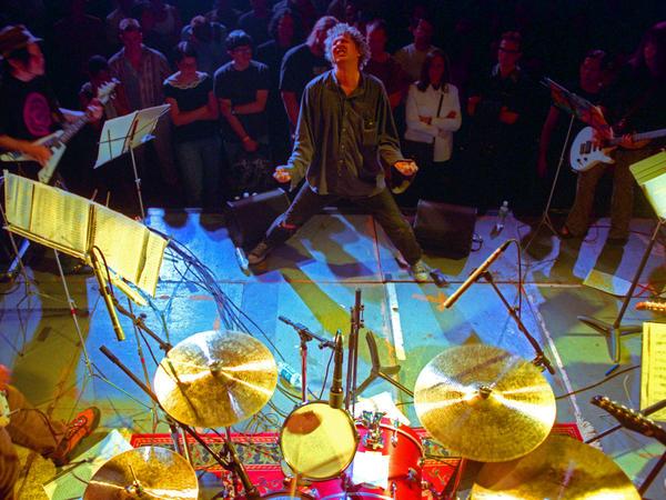 Glenn Branca, conducting his ensemble in Brooklyn in 2000.