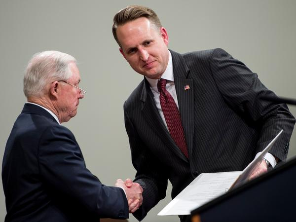John Gore, acting head of the Justice Department's civil rights division, (right) shakes hands with U.S. Attorney General Jeff Sessions in Washington, D.C., in April.