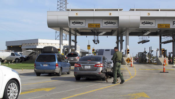 Vehicles wait for inspection at the Border Patrol's Laredo North vehicle checkpoint in Laredo, Texas. A border agent killed an immigrant woman in Rio Bravo, near Laredo on Wednesday. The shooting is being investigated by the Texas Rangers and the FBI.