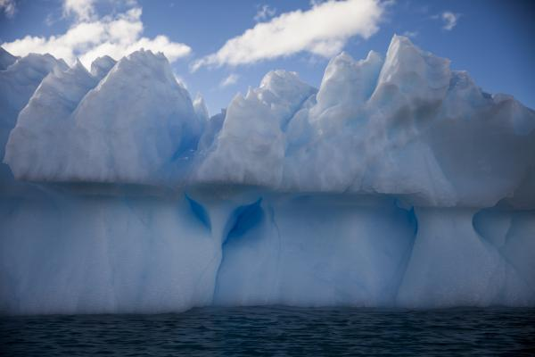 The texture and shapes of icebergs are caused by many different forces, such as the movement of water and air around and through the ice.