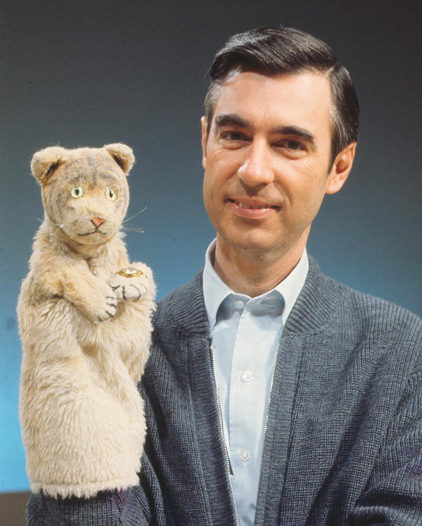 "Along with his trusty puppet, Daniel Tiger, Fred Rogers explained a complex world to kids in terms they could understand. His goal, says filmmaker Morgan Neville, was to ""allay fear and promote love."""