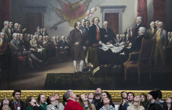 Tourists look up to the Capitol Rotunda as they stand in front of John Trumbull's Declaration of Independence painting on March 10, 2014.