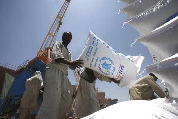 Sudanese dockworkers unload bags of grain from a U.S. ship at Port Sudan on the Red Sea.