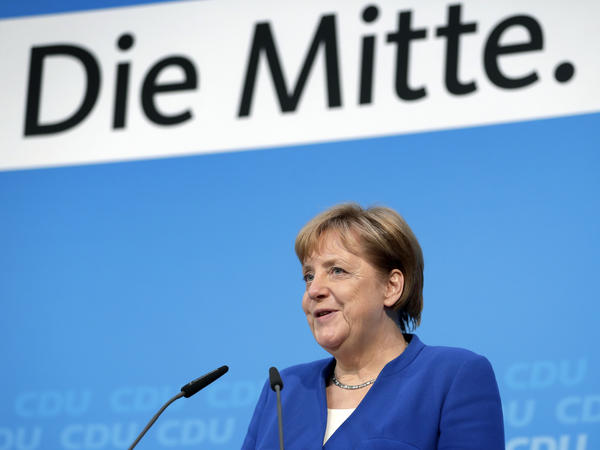 German Chancellor Angela Merkel, who is also chairwoman of the German Christian Democratic Union, announces a new deal with Horst Seehofer, the interior minister and chairman of Bavaria's Christian Social Union, in Berlin on Monday.