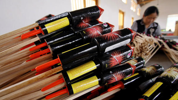 A worker assembles parts of a rocket firework at Southern Fireworks Manufacturer's factory in in 2008 in Liuyang, China, in Hunan province, Thursday June 19, 2008. Most American fireworks are imported from China. (AP Photo/Eugene Hoshiko)