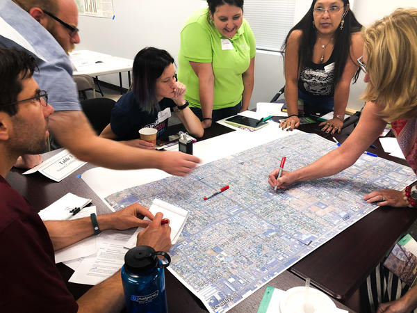 Locals of a neighborhood east of Phoenix map out the heat footprint at a community workshop held by researchers at Arizona State University and The Nature Conservancy. It's part of a broader effort to come up with strategies for cooling some of the hottest neighborhoods.
