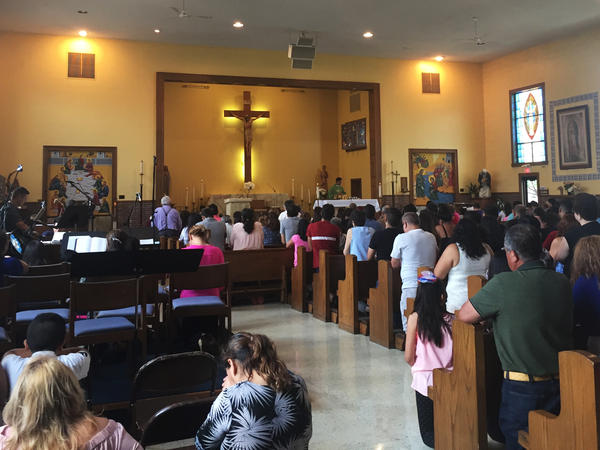 Worshippers at St. Alexis pray during a Spanish-language Sunday Mass.