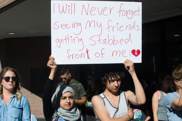 16-year-old Younis Kamel, right, says he witnessed Saturday night's mass stabbing attack.