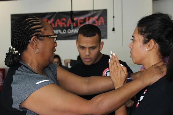 Yessenia Urena practices Brazilian Jiu-Jitsu with class member Terri Rose in West Palm Beach's Oskarate USA. Urena provides these free self-defense classes under her nonprofit, End Rape Culture.