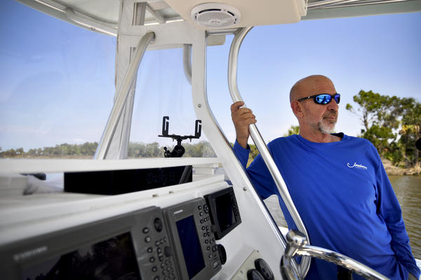 Captain Bill Phillips, a Yankeetown fishing guide, believes sea-level rise and climate change are affecting his catch. Fisheries are an important economic engine in the area.