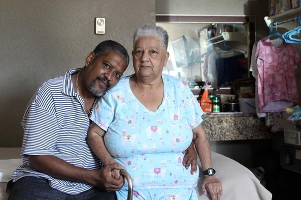 Julio Ildefonso and his mother Mariana Vazquez fled Puerto Rico after Hurricane Maria. They are currently living in a motel room near Busch Gardens.