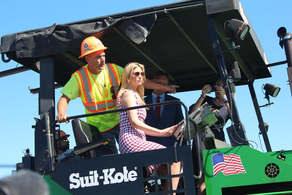 Ivanka Trump drives a Suit-Kote paver in Tully.