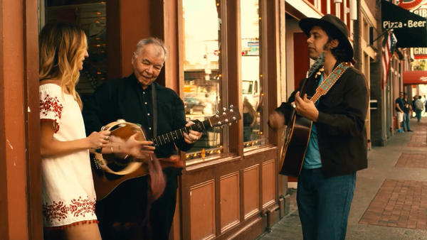 Margo Price (left) with John Prine and Jeremy Ivey outside the Ernest Tubb Record Shop in downtown Nashville.