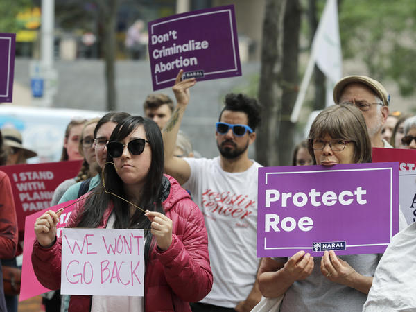 Abortion-rights supporters in Seattle protest on Tuesday against President Trump and his choice of federal appeals Judge Brett Kavanaugh as his second nominee to the Supreme Court. Activists are preparing for the possibility that Kavanaugh's confirmation could weaken abortion rights.