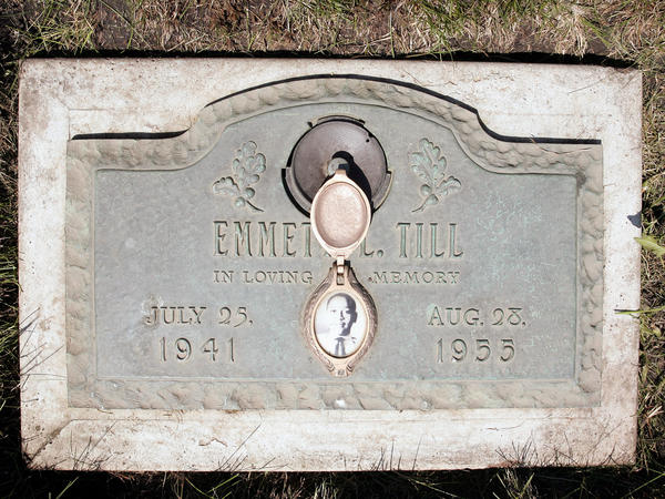 A plaque marks the gravesite of Emmett Till at Burr Oak Cemetery in Aslip, Ill. No one was convicted in his 1955 lynching.
