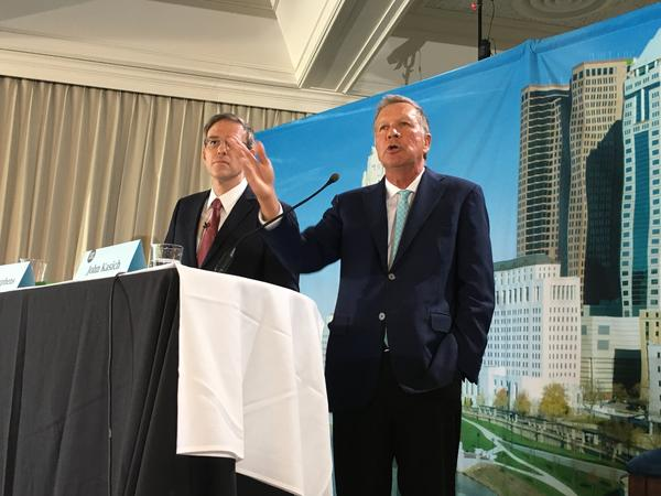Gov. John Kasich (right) takes a question at the Columbus Metropolitan Club, where he appeared with New York Times columnist Bret Stephens.