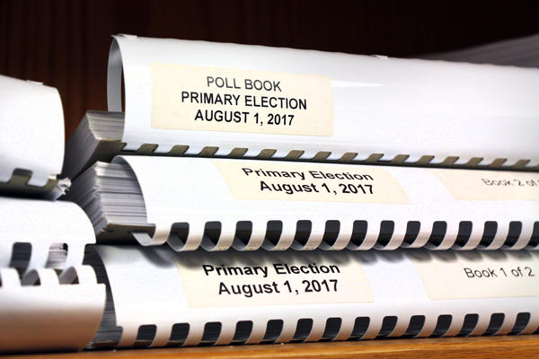 After a federal court ruling, county election offices in Kansas have to make sure that voters appear correctly in their poll books.